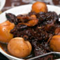 Thumbnail: pork knuckles, ginger and eggs in black Chinese vinegar
