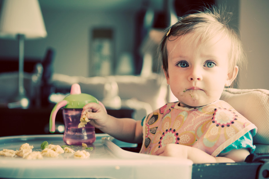 baby eating on high chair