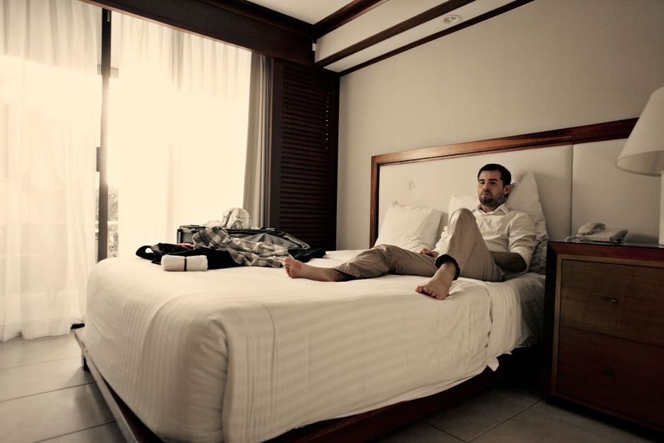 man in khakis on bed