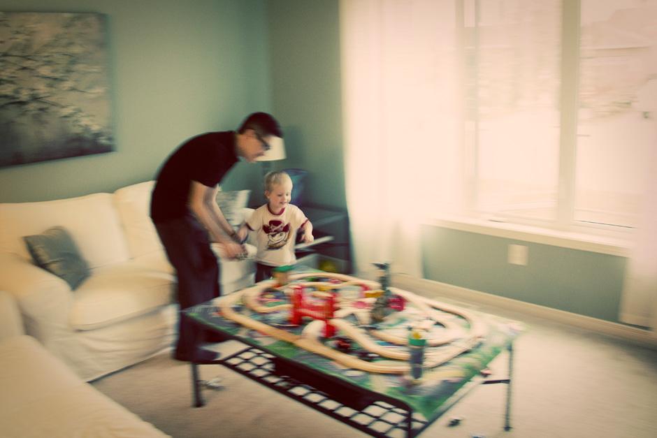 boy plays with man