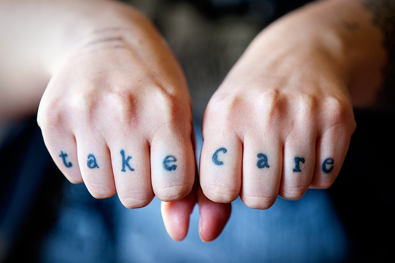 Rosie's knuckle tattoos