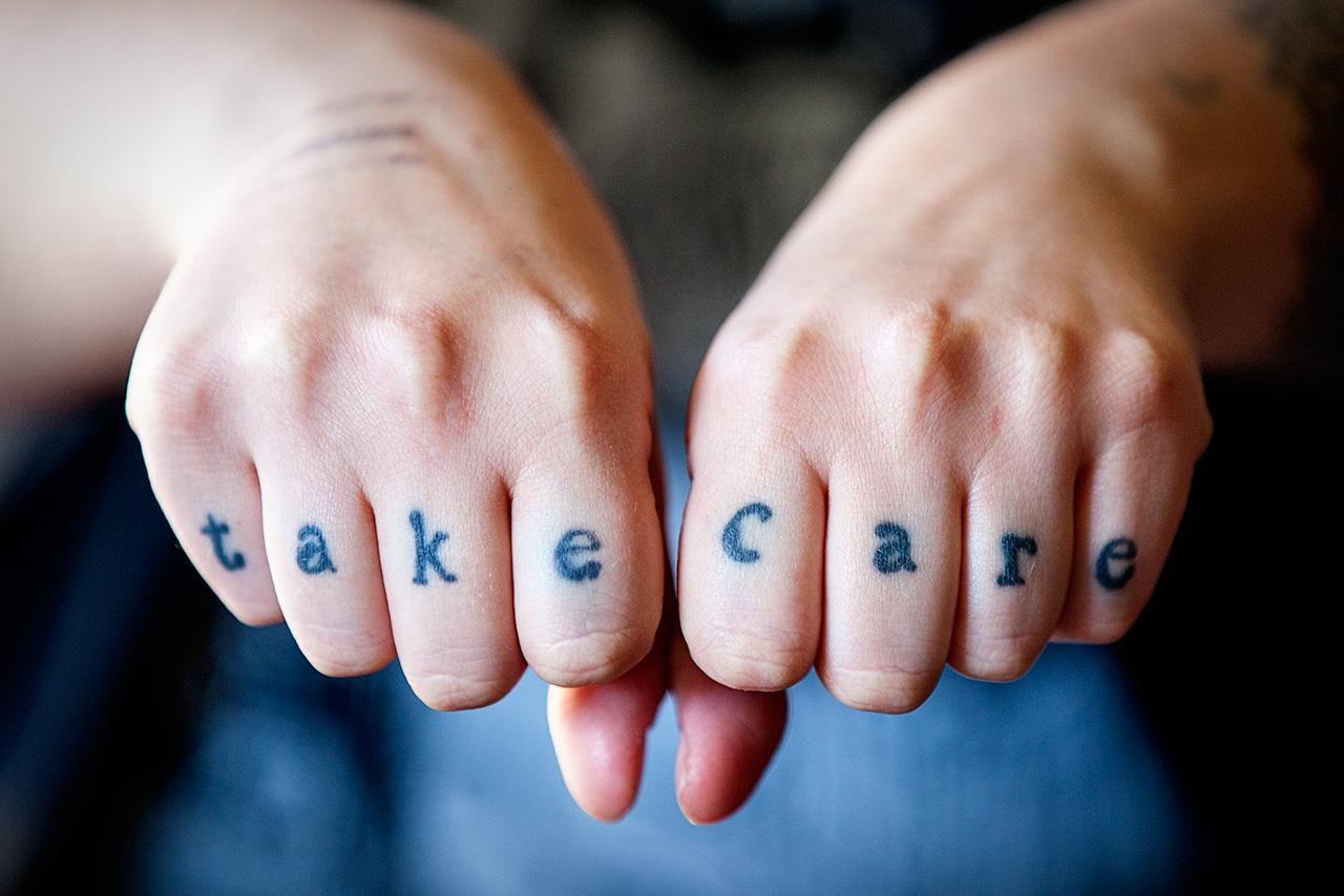 Rosie's knuckle tattoos